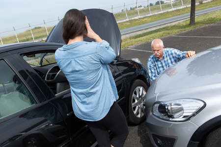 mid thirties: two drivers arguing after traffic accident
