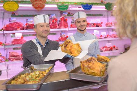 transact: buying a roast chicken Stock Photo