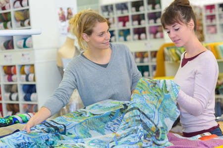 Women looking at textiles Reklamní fotografie