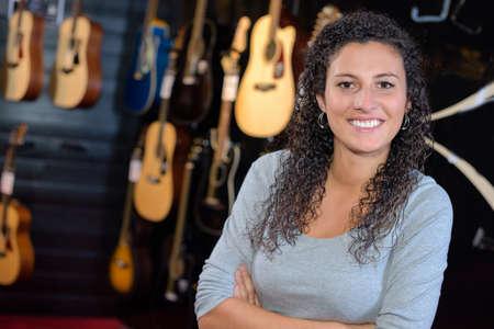 proprietor: Portrait of lady in guitar shop