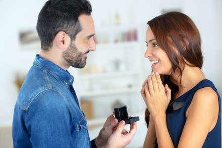 propose: Man proposing to his girlfriend Stock Photo