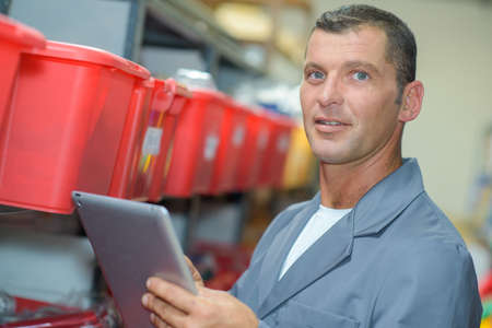 categorized: Man in storeroom with tablet