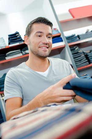 looker: man buy jeans Stock Photo