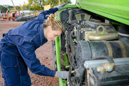 combustion chamber: Woman working on engine of plant machinery