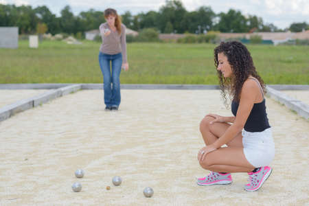 Women playing petanque Stock Photo