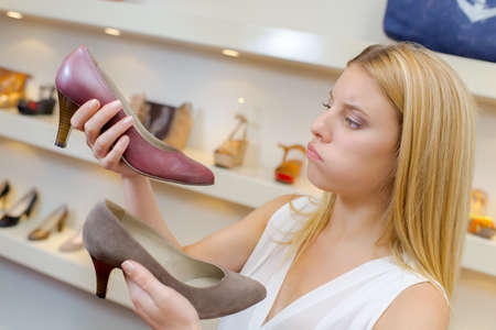 shopping questions: Lady trying to decide between two shoes