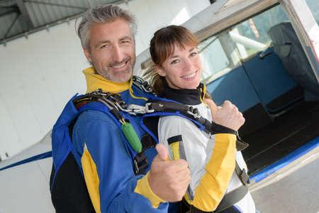 parachutists: Parachutists making thumbs up gesture