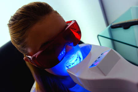 dental resin: Woman having ultraviolet dental treatment Stock Photo