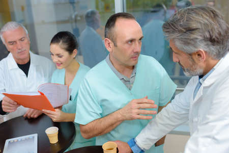 confer: Medical staff talking while on break Stock Photo