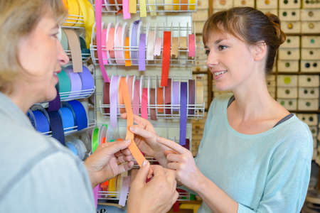 Women looking at shades of ribbon