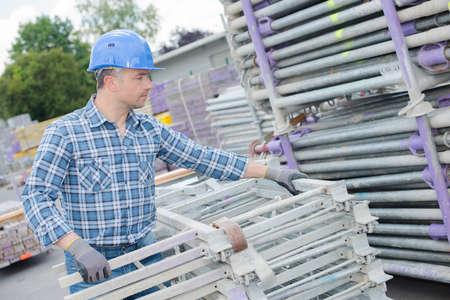 scaffolds: Worker stacking scaffolding
