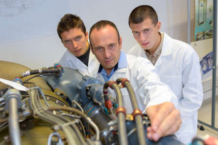 service engineer: materials engineers studying the system