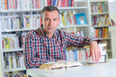 man with books posing