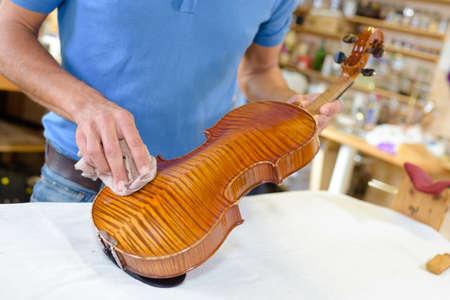 craftsmanship: wiping a violin