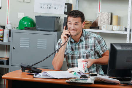 exalted: Office worker receiving exciting news Stock Photo