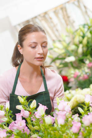 Florist stood in her boutique Stock Photo