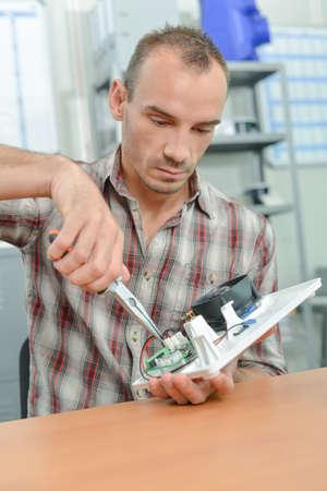 elevation meter: Electrician using pliers