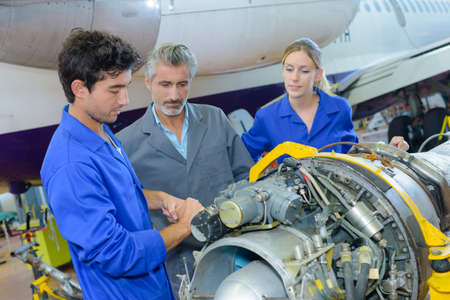 chamber of the engine: Students working on aircraft component