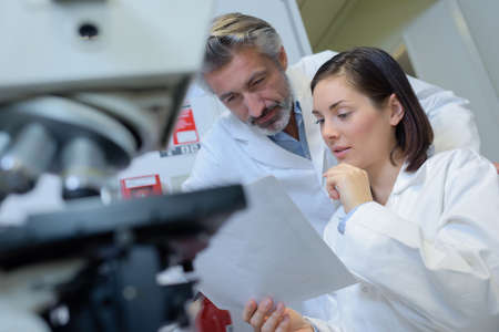 clinical staff: finding unusual on the lab record Stock Photo