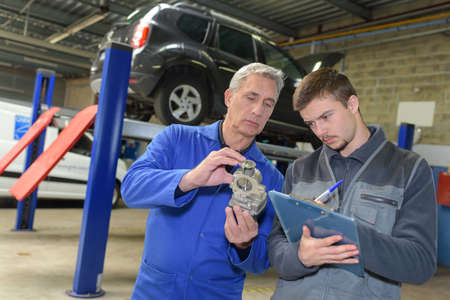 student with auto part studying automotive trade Stock Photo