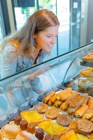 serf: woman looking at pastries