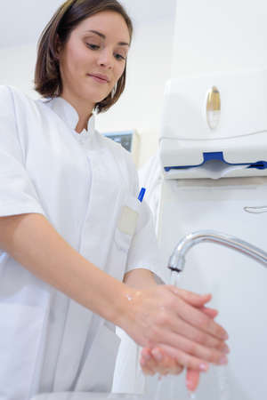 rinsing: practitioner washing her hands
