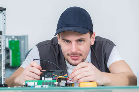 computer devices: electronic engineer repairing electronic devices on broken computer