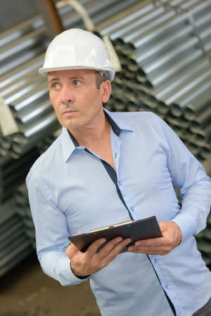 remediation: warehouse manager checking the products