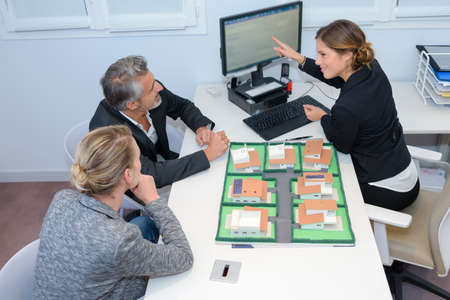 property development: Executive with couple discussing property development