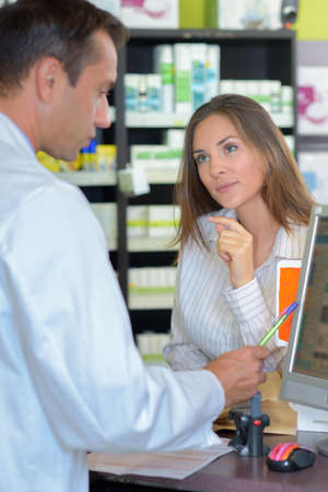 oversee: woman in the pharmacy Stock Photo