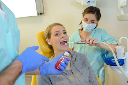 sufferer: dentist curing a woman patient in the dental office