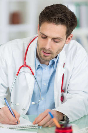male doctor with notebook close up
