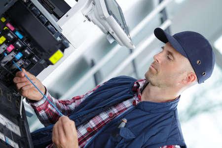 photocopy: technician man repairing photocopy machine Stock Photo