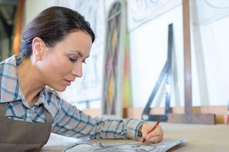 art activity: Left handed artist sketching Stock Photo