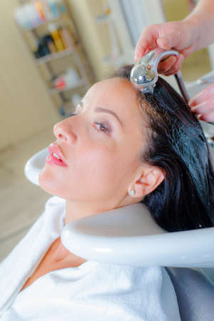 faraway: Lady having hair rinsed in salon