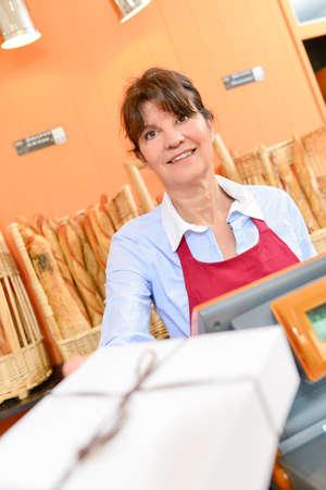 proprietor: Lady serving box in bakery