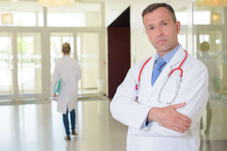 doctor with stethoscope posing Stock Photo