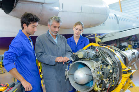 critical conditions: inspection of aircraft mechanism Stock Photo