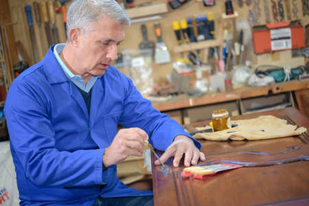 skilled wood worker working with wood Stock Photo