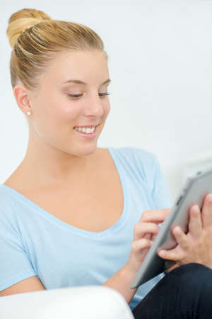 young lady: Young lady using tablet