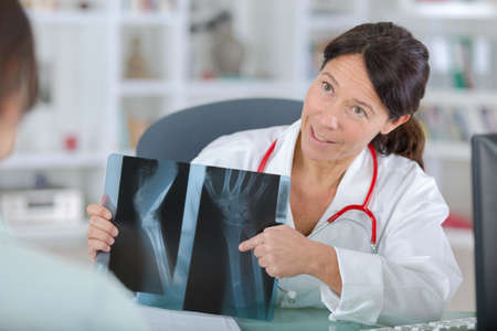 doctor shows a patient x-ray image