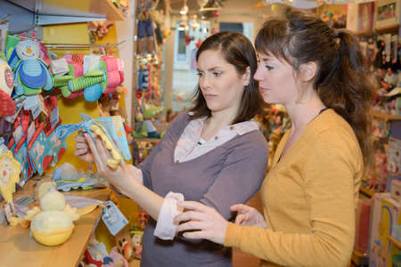shoppingcarts: family of four in shop with toys