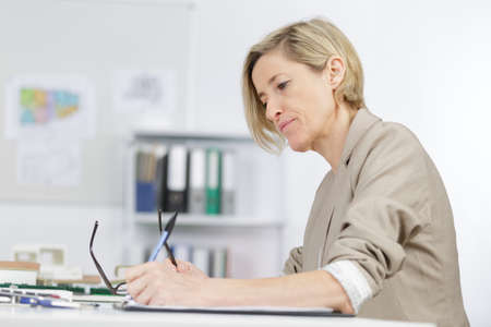 female architect: portrait of female architect working in the office
