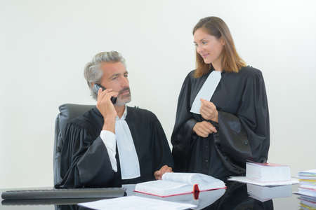 telephone call: judges making telephone call Stock Photo