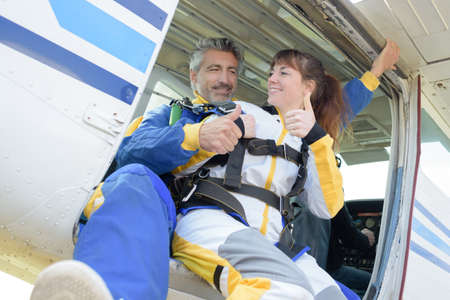 skydive: Man and woman giving thumbs up before skydiving Stock Photo