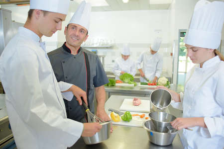 trainees: Chef supervising trainees