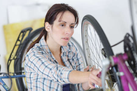 defect: unhappy woman with defect bike