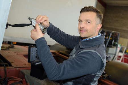 mechanician: mechanician at work in the auto repair garage Stock Photo