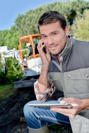 foreman: Foreman using a mobile phone Stock Photo