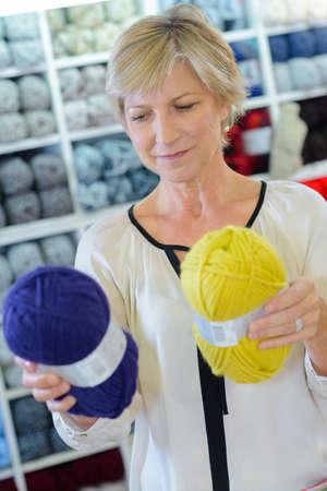 choosing wool at haberdashery Stock Photo
